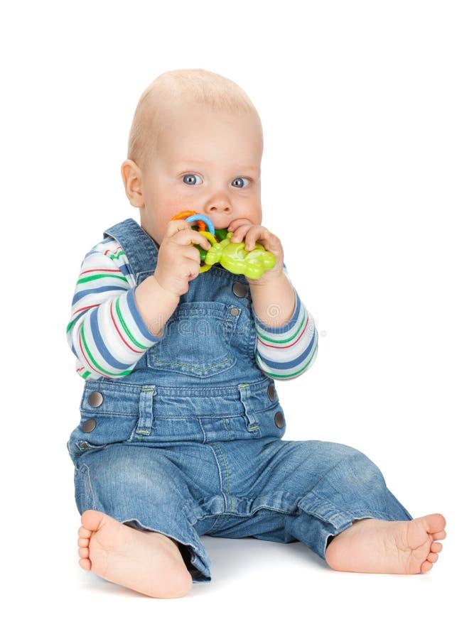 拿着玩具的小男婴 免版税图库摄影