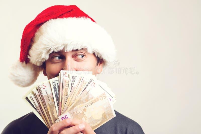 拿着现金的圣诞老人项目,隔绝在白色 圣诞节购物时间 圣诞节,假日,赢得,货币和人概念 免版税库存图片