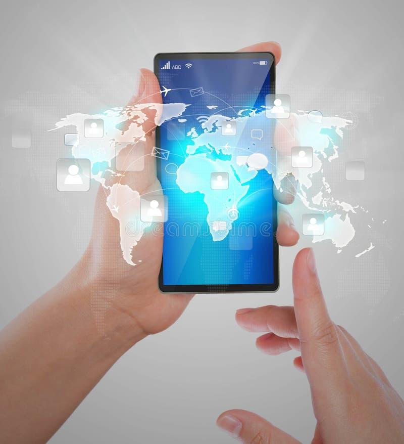 拿着现代通讯技术手机的手 免版税库存照片