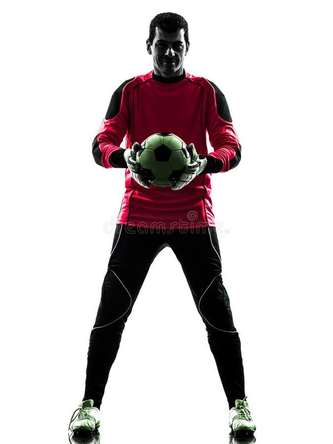 拿着球剪影的白种人足球运动员守门员人 免版税库存照片