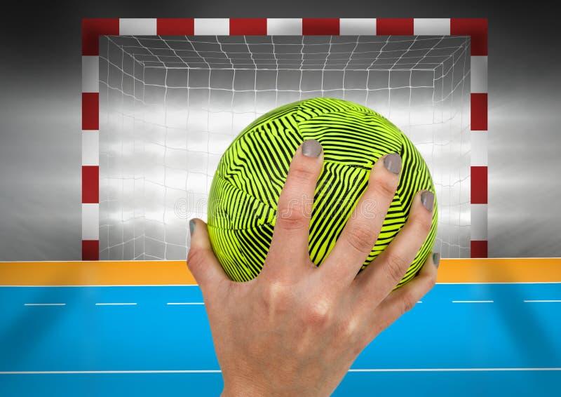 拿着球的手反对目标岗位 库存图片