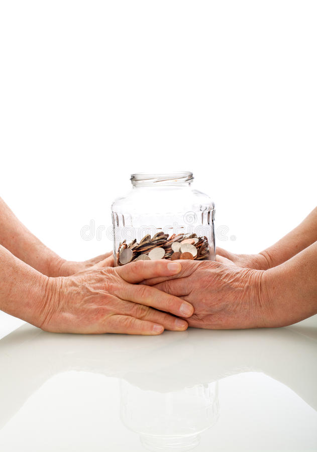拿着瓶子的硬币现有量高级 免版税图库摄影