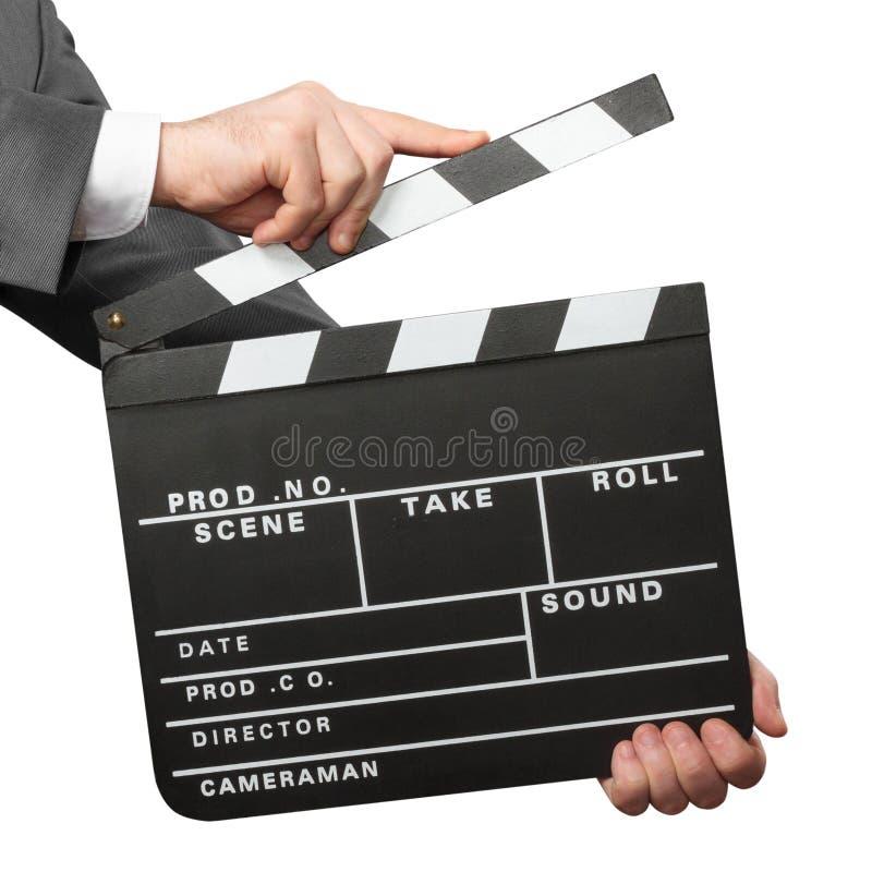 拿着电影拍板的手特写镜头  免版税库存图片