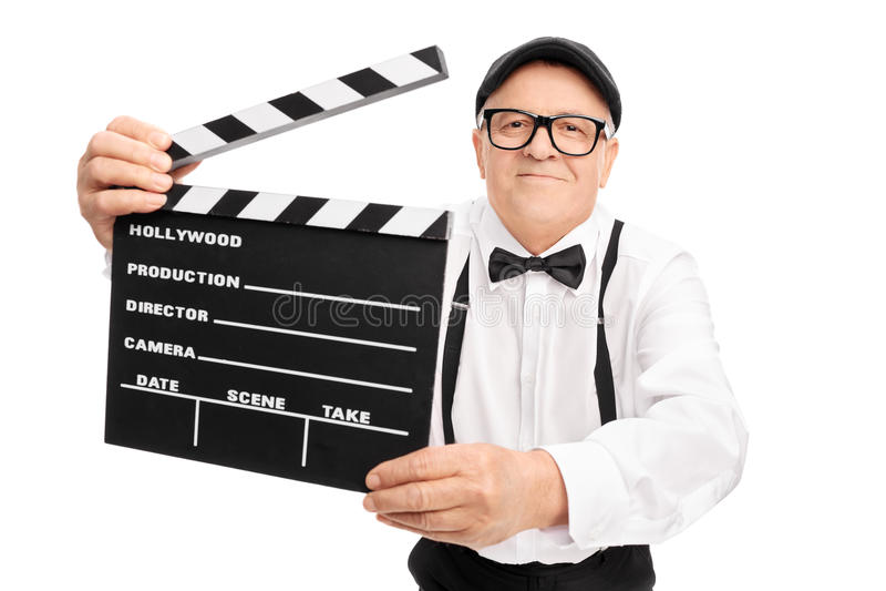 拿着电影拍板的高级电影导演 库存照片