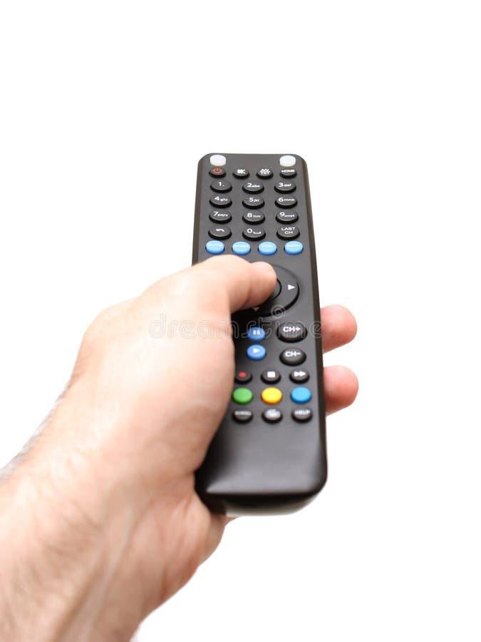 拿着电视的手遥远 免版税库存图片