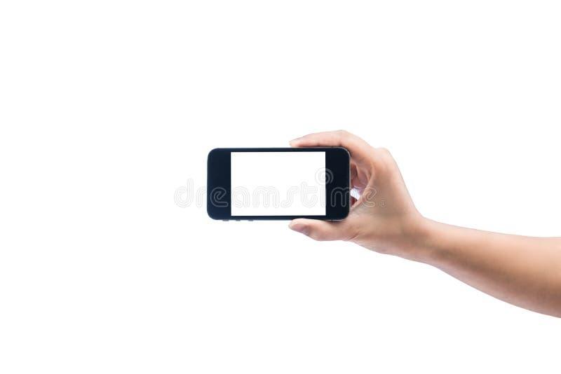 拿着电话片剂接触计算机gadg的被隔绝的妇女手 库存照片