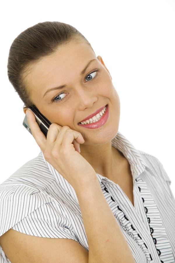 拿着电话的少妇 免版税图库摄影