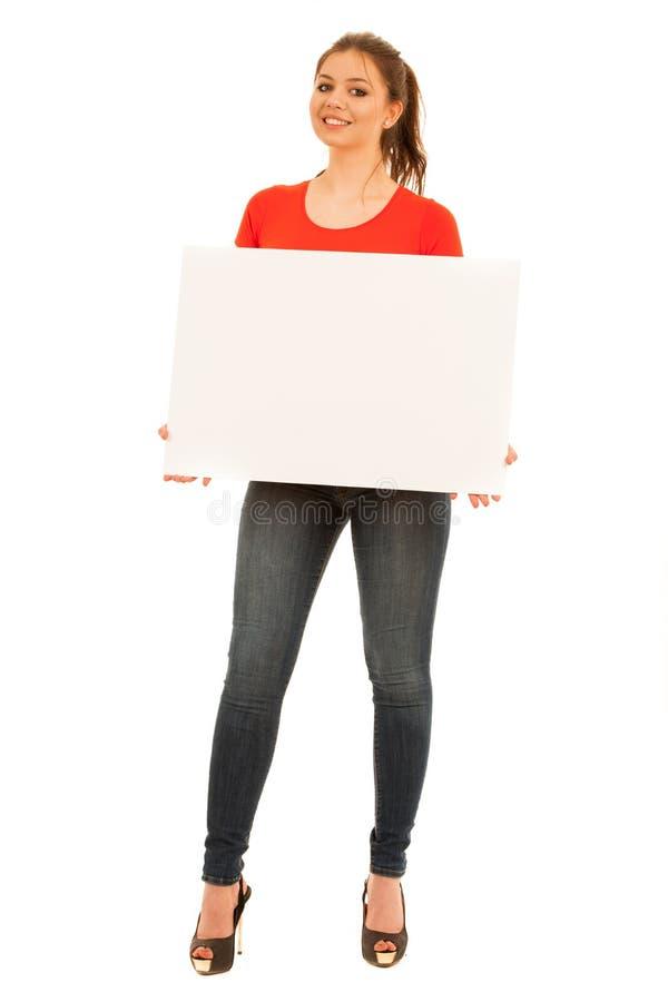 拿着白板的少妇被隔绝在白色背景 免版税库存照片