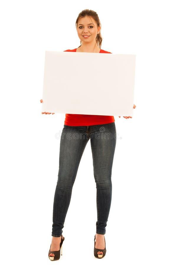 拿着白板的少妇被隔绝在白色背景 库存图片