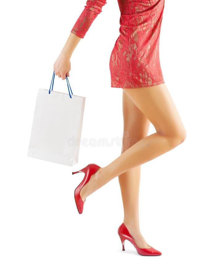拿着白皮书袋子的女性 库存照片