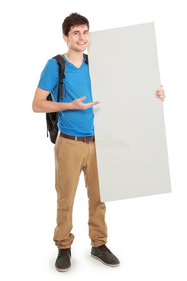 拿着白空白的委员会的年轻男学生 库存图片