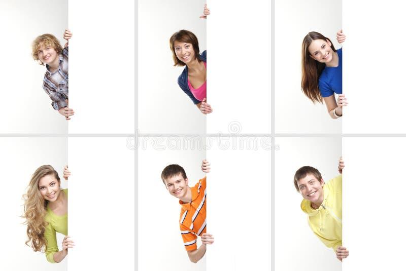 拿着白色横幅的少年拼贴画  库存照片