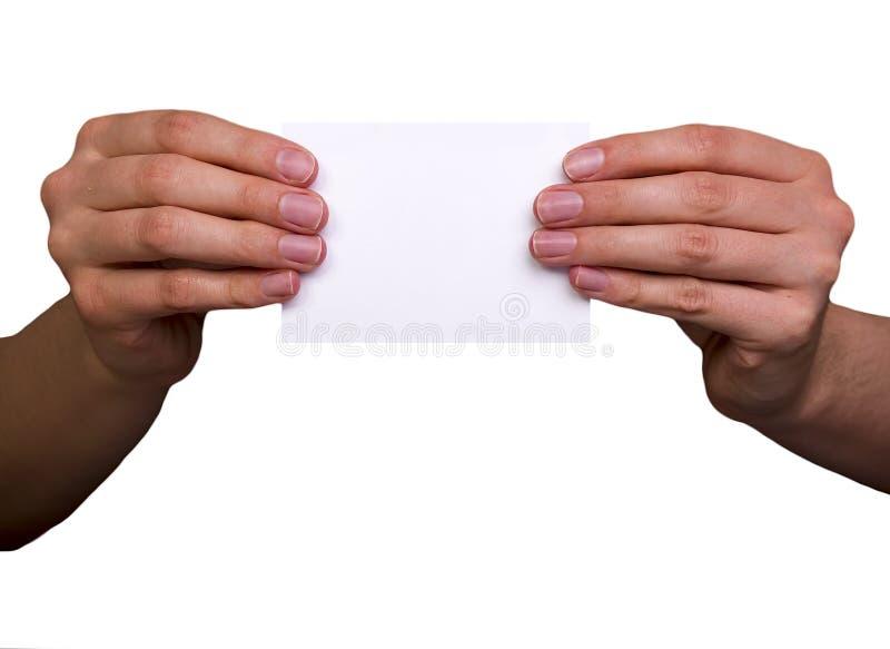 拿着白色空插件的女性手 免版税库存照片