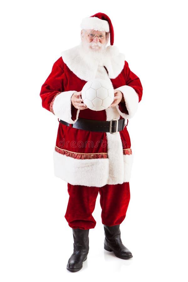 拿着白色足球的圣诞老人 库存图片