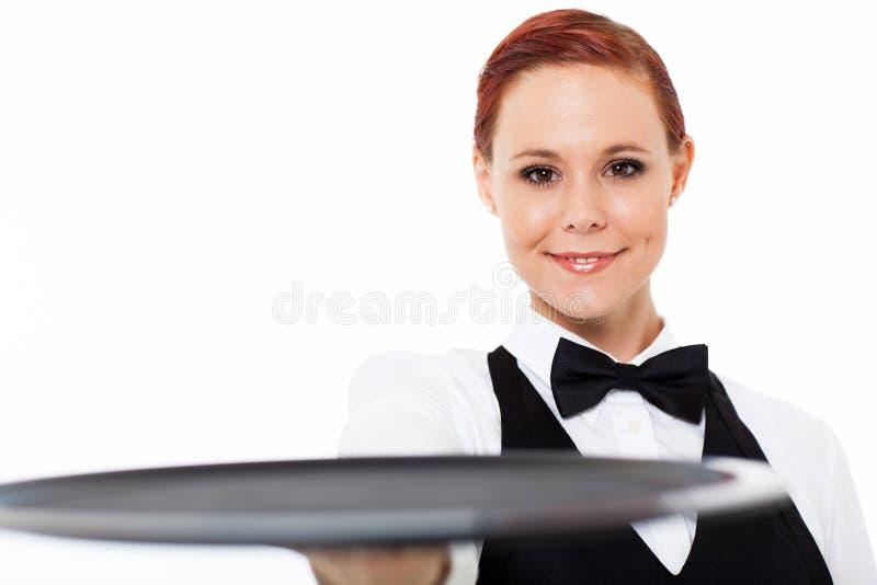 拿着盘的女服务员 库存照片