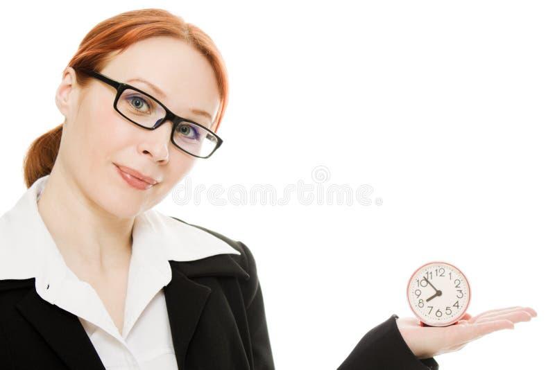 拿着相当微笑的妇女的时钟 库存照片