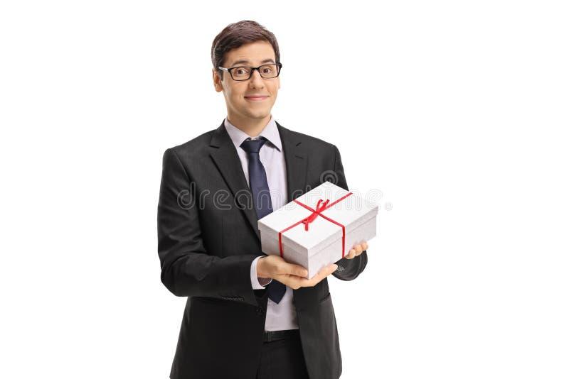 拿着礼物的商人 免版税库存图片