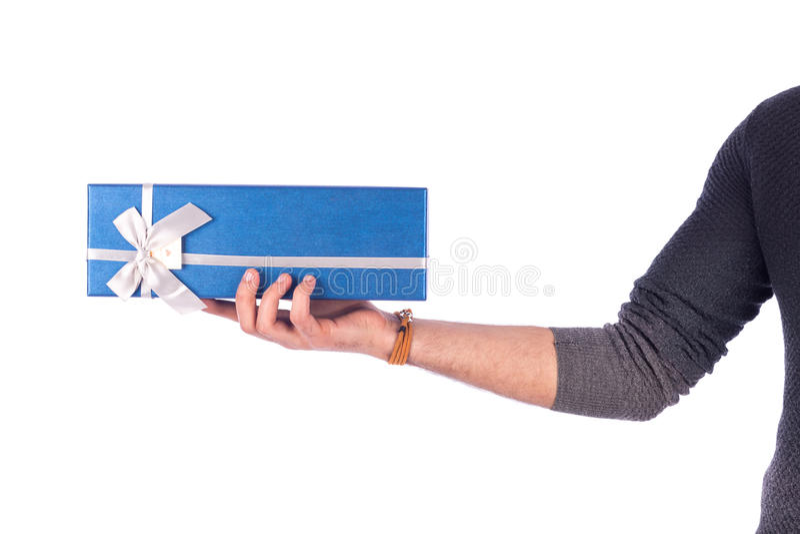 拿着礼物的手 免版税库存图片