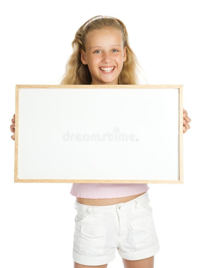 拿着空白年轻人的横幅女孩 库存照片