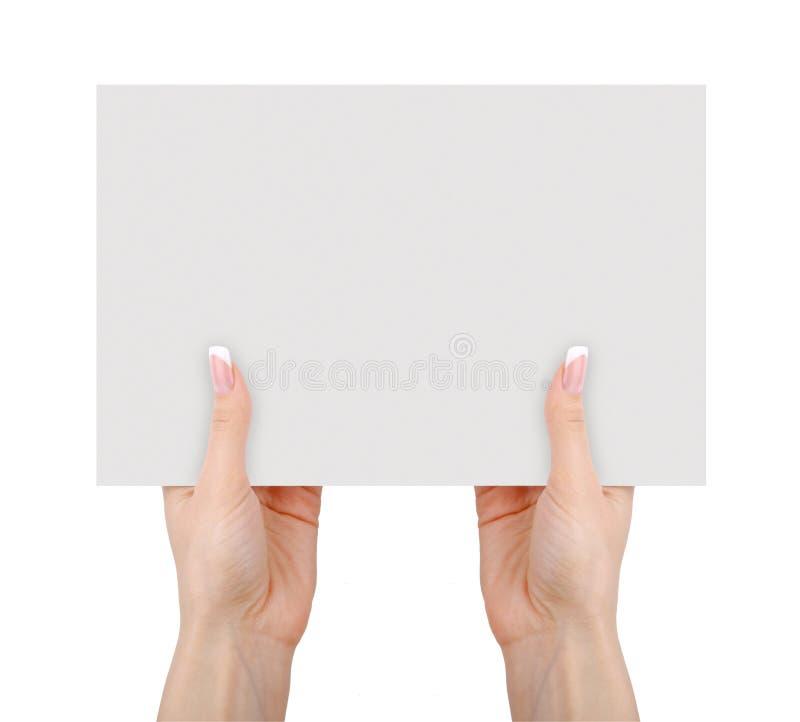拿着空白的白皮书的手被隔绝 库存图片