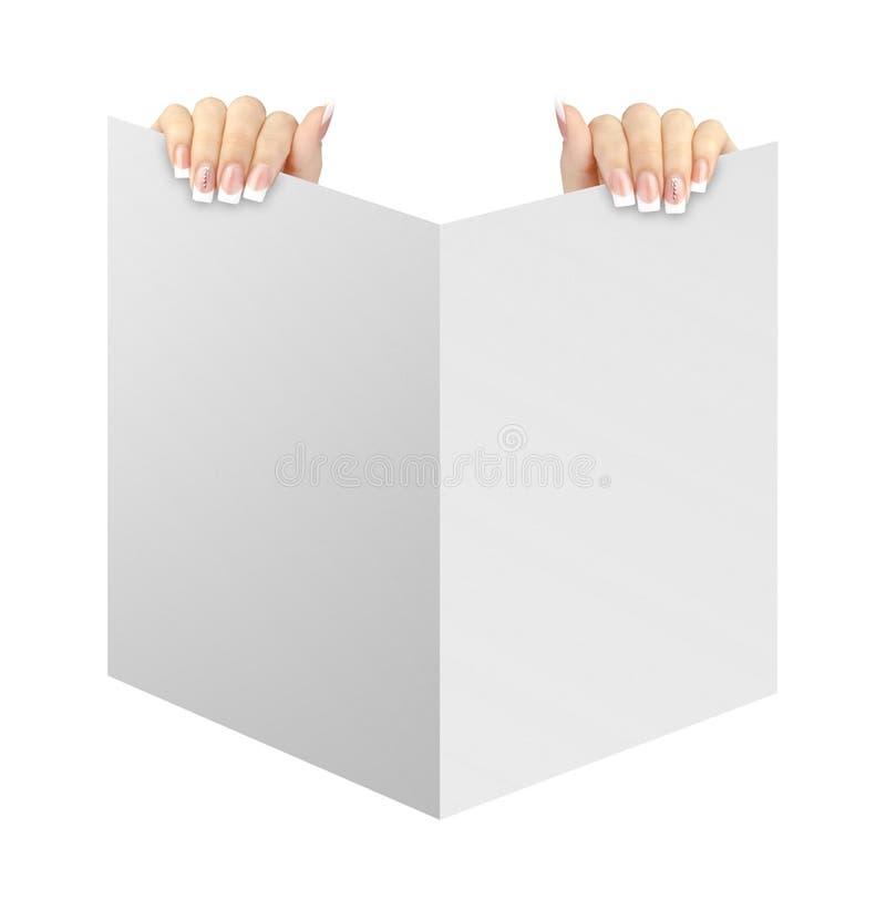 拿着空白的白皮书的手被隔绝 图库摄影
