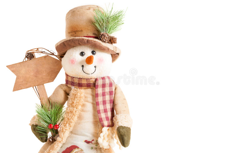 拿着空白的箭头标志的雪人 库存图片