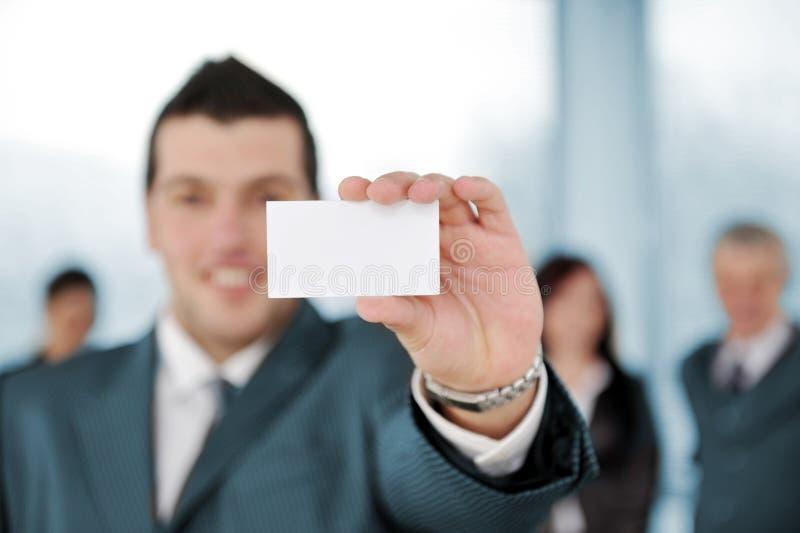 拿着空白符号的生意人 图库摄影