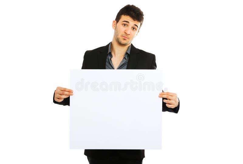 拿着空白董事会的新生意人 免版税库存照片