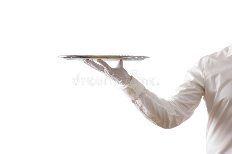 拿着空的银色盘子的侍者 库存图片