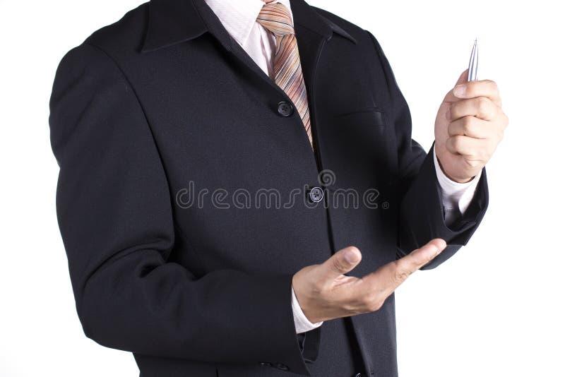 拿着笔的商人 免版税库存照片