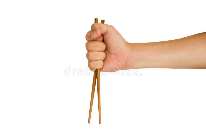 拿着筷子的手 库存图片