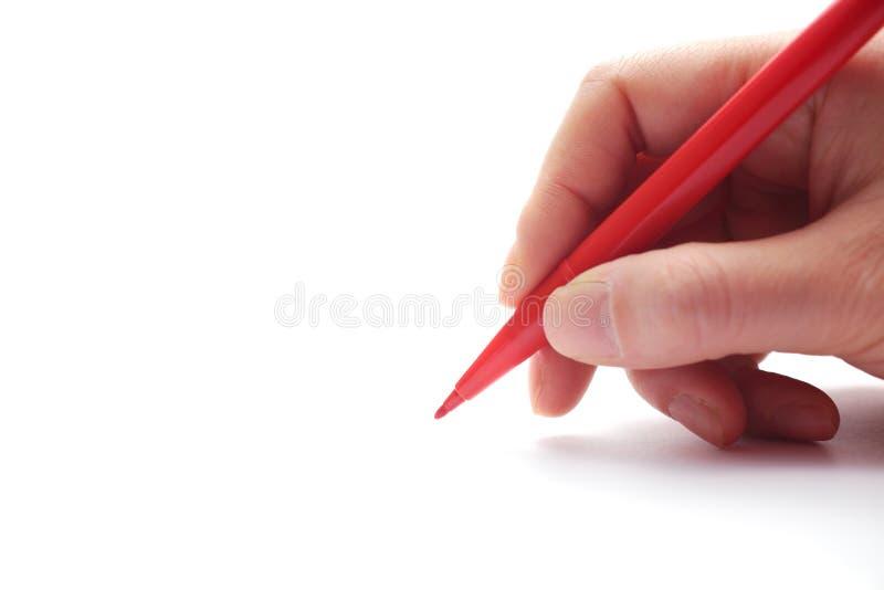 拿着红色笔的女性现有量 免版税库存照片