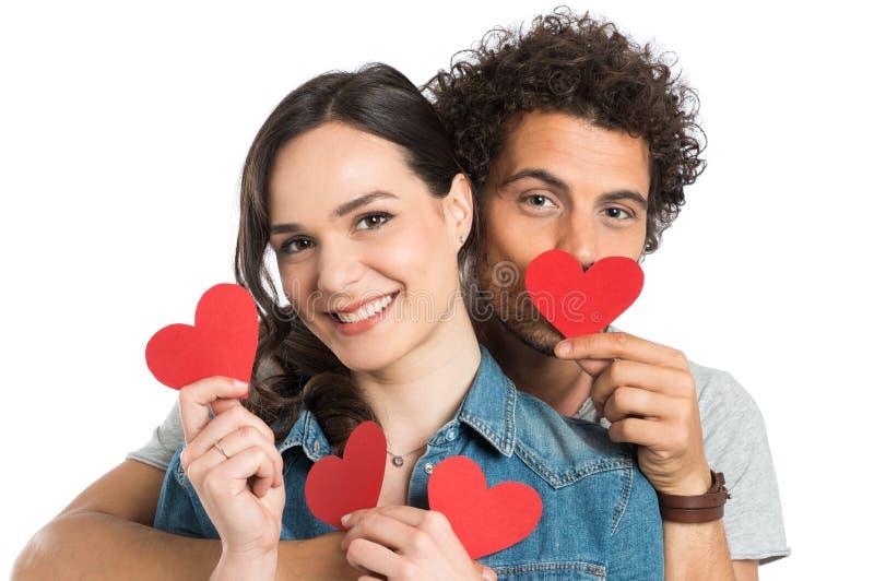 拿着纸心脏的夫妇 库存照片