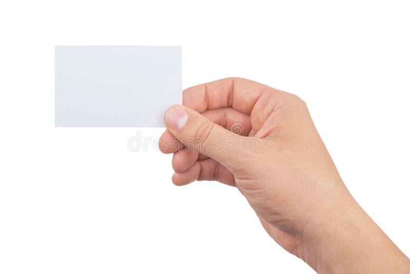 拿着纸牌的人的手被隔绝在白色背景 库存图片