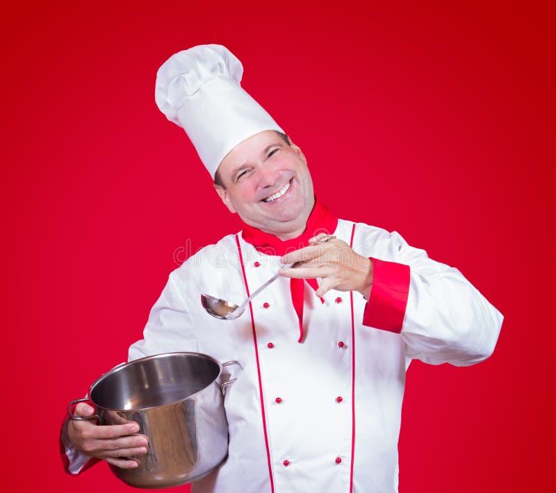 拿着罐的快乐的厨师 免版税库存照片