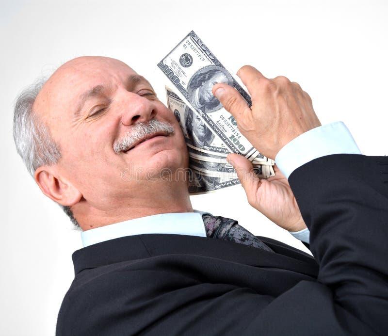 拿着美元的人 免版税库存图片