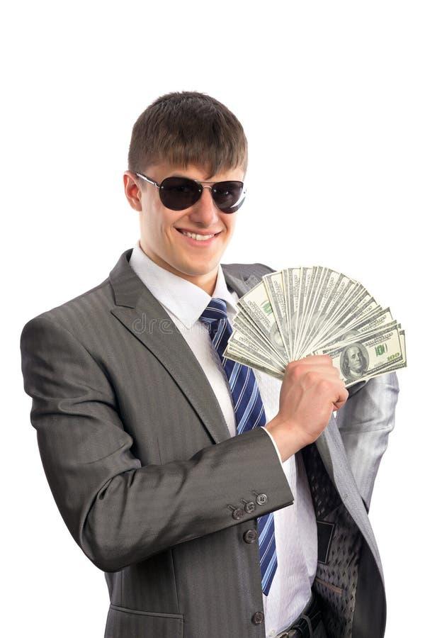 拿着美元的新生意人 库存图片