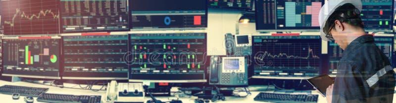 拿着股市的工程师人两次曝光片剂 库存图片