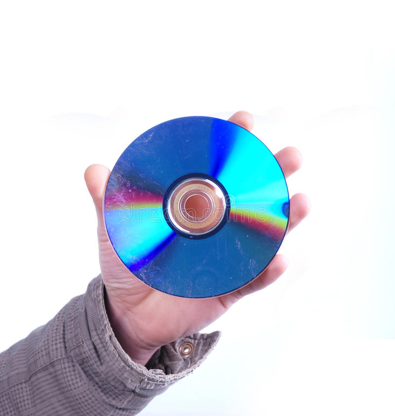 拿着肮脏的dvd圆盘的男性手 图库摄影