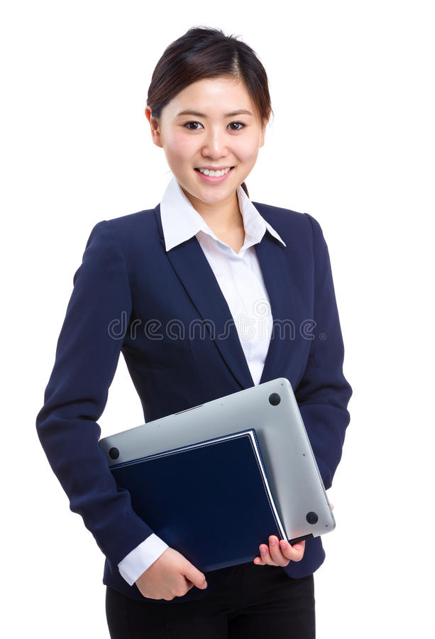 拿着膝上型计算机和笔记本的女商人 库存图片