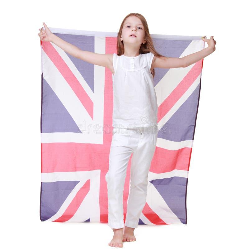 拿着英国旗子的美好的一点gir 库存照片