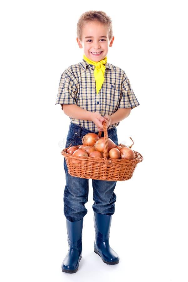 拿着葱的小农业学家 库存图片