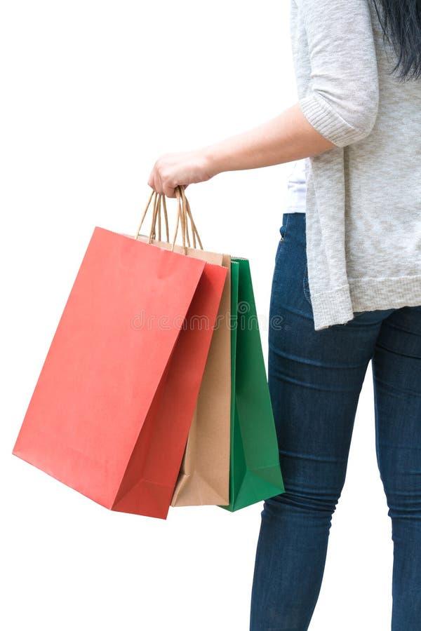 拿着袋子的购物妇女被隔绝在白色背景,consum 免版税图库摄影