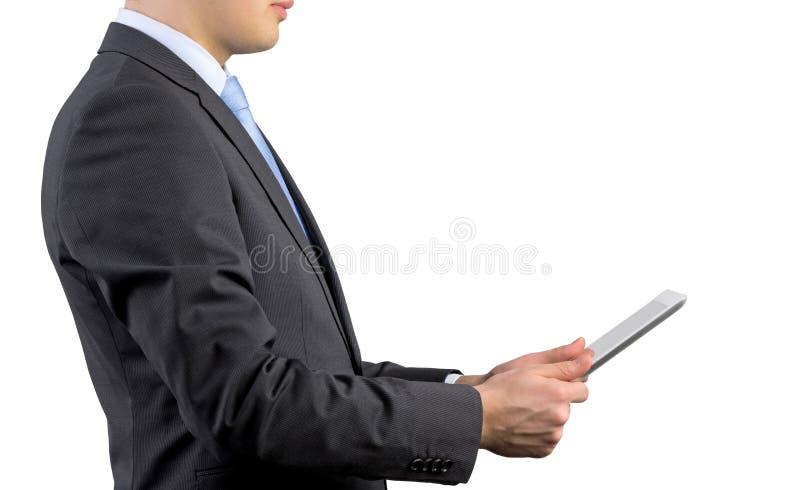 拿着触摸板的商人 免版税库存照片
