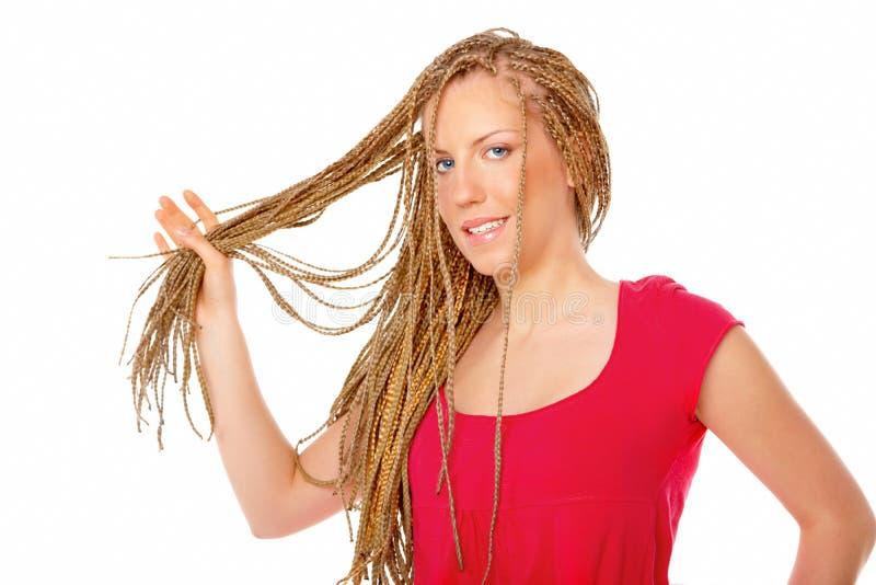 拿着许多褶的美好的女孩头发发型 库存图片