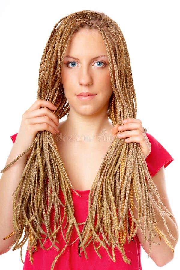 拿着许多褶的美好的女孩头发发型 库存照片