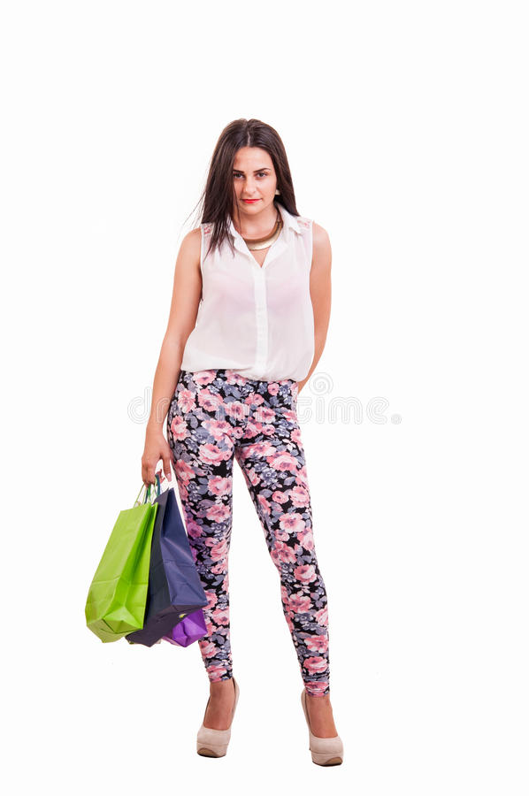 拿着许多购物袋的充分的身体的美丽的妇女被激发 免版税库存照片
