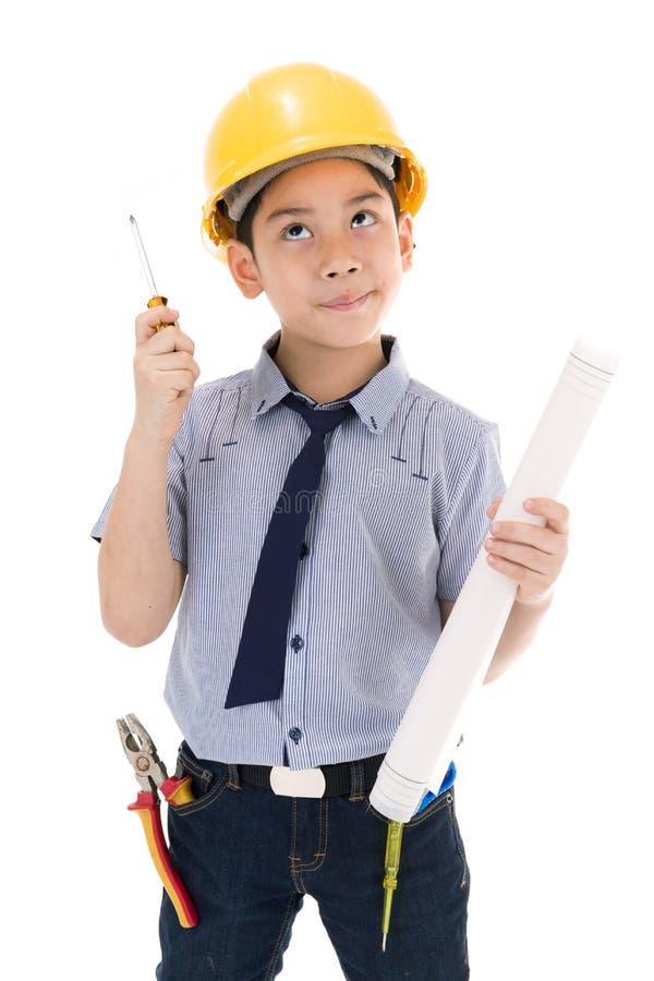 拿着设备的年轻亚裔儿童建筑工程师 库存图片