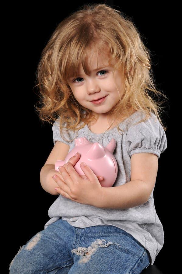 拿着贪心年轻人的银行女孩 库存照片