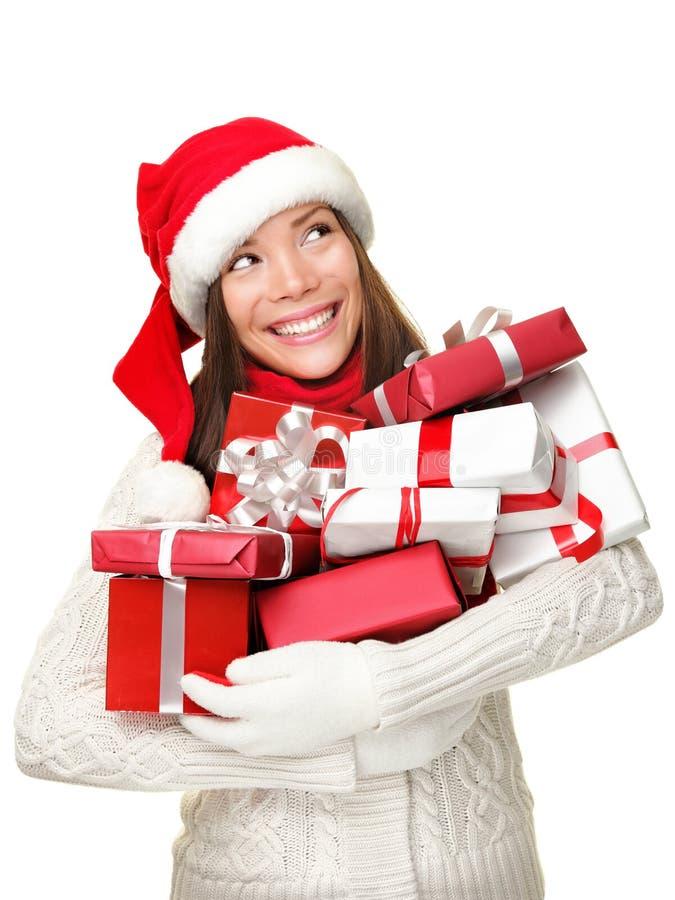 拿着购物妇女的圣诞节礼品 库存图片